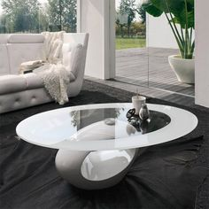 Tonin Dubai Coffee Table: The base allows custom color RAL finishing to customize your ambiance as you wish. The oval tabletop is also available with or without the serigraphy. Dubai table is an original and patented article.
