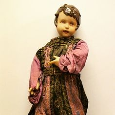 Antique Child Shop Mannequin at D and A Binder | We have wonderful shop display mannequins at Binder's of various sizes ages and styles! This child mannequin is dressed in a possibly early Victorian handmade dress. It has a label identifying it as a Charles H Fox LTD design who were well known for creating theatrical wigs and costumes. We believe this mannequin is quite old and we're estimating it could be Victorian. Come see this wonderful girl - and her intricate dress - at…