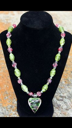 This one is really unique and had a great feeling of Spring/Summer about it! Glass Heart Pendant with Pink & Green Swirls and Pink & Green Glass Beads, Separated by genuine Swarovski Crystals!! $45
