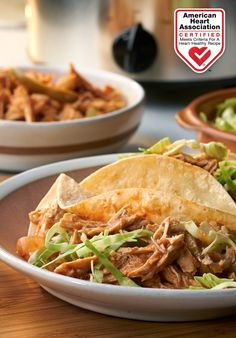 Slow Cooker Chicken Tacos — Tacos are a family favorite, and this tender, flavorful version is fiber-rich and loaded with savory goodness. Heart-Check Certification does not apply to recipes or information reached through links unless expressly stated.