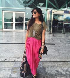 Dhoti and t-shirt: Fashion glocalisation at its best. We love to mix local and western looks just like #thatbohogirl has done here. The electric print dhoti is so hot on its own but we are digging how she has paired it with a casual t-shirt instead of the usual kurta. Shop the look at https://www.estrolo.com/inspirationapp/western-looks/