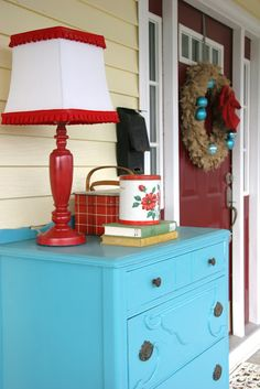 A dresser on the porch. Great look and great storage for seasonal junk.