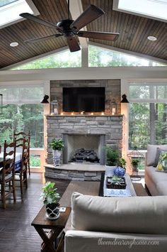 The windows are the real star of this room but the decorating compliments it perfectly. I love the use of plants to bring the outdoors in and the candles to add some warmth. Did I mention the fireplace? Because I love the fireplace.