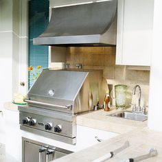 Stumped about how to start designing an outdoor kitchen? Let these 15 tips guide you -- and get you cooking outside. See how to incorporate not only a grill but also other kitchen necessities, such as a sink, refrigerator, and more.