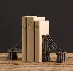 This photo is about the Restoration Hardware bookends, but I am way more interested in the brown paper covered books with pencil numbering and golden wax seals. Such a fab idea, especially for all those ugly, unsophisticated looking paperbacks you just can't get rid of!!