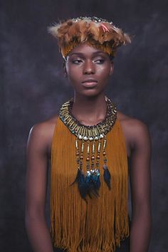 Anita Quansah: Jewelry Curator on the Rise  With intricate detailing mixed with colorful tassels and feathers, let's all take a minute or several to admire the extensive handiwork of Anita Quansah modeled by the beautiful Ayoola Bakare.