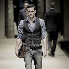 Groom vest and rolled up sleeves look.