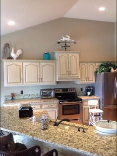cabinet paint color: Silver Pointe (unsure of glaze color). Wall color: Urban Putty/Sherwin Williams