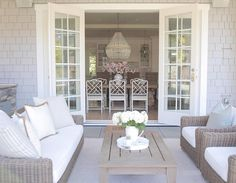 coastal style. Outdoor living. French doors . Patio design . Covered patio. ro sham beaux orbit chandelier. @jshomedesign