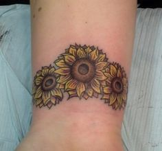 Sunflowers on Wrist by A.R.T. Trained Tattoo Artist Pete Doty. Click to learn more about how to become a tattoo artist.