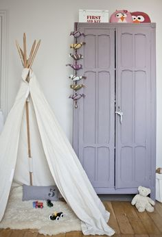 for the kids...well girls who have a touch of tomboy. whats better than a teepee and a painted lavender armoire?