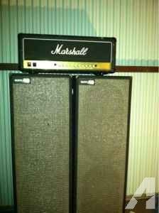 Marshall JCM 900 running into two Sunn cabs. Thick as shit.