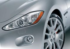 The front headlights are an aggressive addition to the radically sloping front bumper, a stylistic element that has long distinguished Maserati coupés.