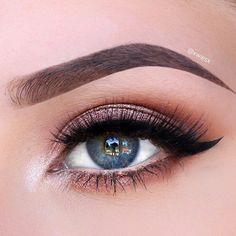 Rose-gold eyeshadow with winged liner