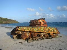 Tank on Flamenco Beach, Puerto Rico - While the U.S. Government originally upheld the right of the Navy to use the island for military practice, it was met with massive resistance from its inhabitants and surrounding cities. Threatening to use force to remove the U.S. Military presence from their shores, protests quickly turned to riots and rioting quickly turned violent.