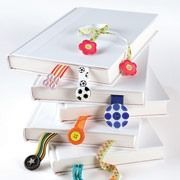 These are fun and easy for kids to create, and great to give as simple gifts.Shown here are just a few of the decorating options: sandwiching the ribbon's ends between two buttons