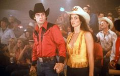 """Actor John Travolta and Madolyn Smith Osborne walk in a scene of the Paramount Pictures movie 'Urban Cowboy"""" circa Get premium, high resolution news photos at Getty Images John Travolta, Urban Cowboy Movie, Cowboy Films, An Officer And A Gentleman, Boogie Nights, Actor John, Cowboy Party, Western Movies, Old Movies"""