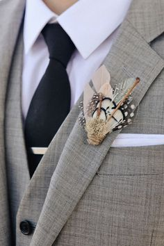 feathered boutonniere | Photo by Edyta Szyszlo, Floral design by Atelier Joya