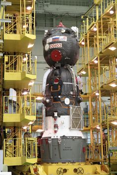 Soyuz spacecraft assembly. The Orbital module is at the top, the Crew capsule in the middle and Service module at the bottom. The first two modules are covered with thermal blankets.