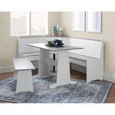 Open up your family gathering space to new possibilities with this versatile breakfast nook. Whether you?re looking to add new life to your kitchen corner, repurpose extra space in your living room, or outfit your home bar with a modern coastal look, this 3 piece set is up to the task. The solid MDF frames are painted white, while the table and bench tops are made of solid pine and stained with a rustic grey wash finish. Seat up to 5 and enjoy hidden storage compartments in the two corner benche Corner Bench Kitchen Table, Nook Table, Small Kitchen Tables, Kitchen Seating, Banquette Seating, Kitchen Benches, Dining Nook, Corner Bench With Storage, Kitchen Ideas