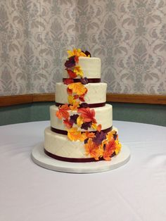 Our beautiful wedding cake! 10/12/2013 Wolford/Conklin. Perfect for a fall wedding. Alternating white/chocolate with quilted buttercream, fondant leaves, and ribbon around each tier.