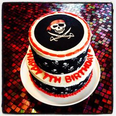 Pirate cake using edible cake tattoos and fondant letters/borders.