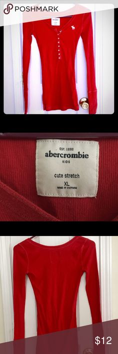 Abercrombie Girls LS Henley This red, long sleeve, girls size XL Abercrombie henley looks great with a pair of jeans. It has the old style long cuffs that extend over your hand. You can also wear this as a base layer under a sweater or flannel shirt for a cute alternative. abercrombie kids Shirts & Tops Tees - Long Sleeve