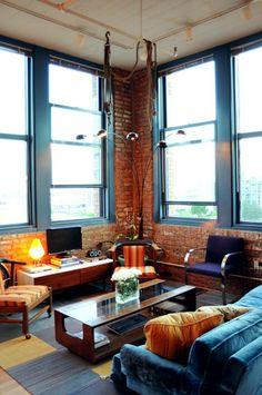 Arthur & Kristin's Sunny Vintage Loft House Tour   Apartment Therapy. Those big windows...aahh!!