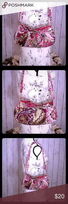 Vera Bradley Handbag Crossbody Beautiful Floral Super cute Vera Bradley handbag, beautiful floral patterns and colors, adjustable shoulder strap approx 12-24 inches long to use as a shoulder bag or crossbody, smaller bag, approx 9 in long, 5 in tall, 3 in wide, very gently used, very good condition, there is a small mark on the inside logo (see pic), but other than this, the bag is in overall excellent condition. Vera Bradley Bags Shoulder Bags