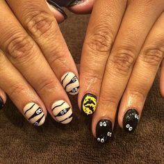 From Spooky Stripes & Bloody French Tips to Skeletons in Your closet, these manicures will give you the perfect look for Halloween!
