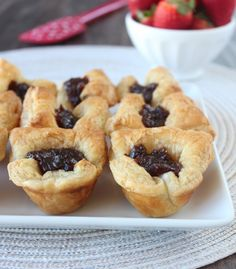 Easy Appetizer Recipe: Fig & Baked Brie Puffed Pastry Bites. Made with just 3 ingredients (puff pastry dough, fig jam, and brie).