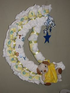 Diaper wreath/ Moon and Stars $35 I can add additional baby items if desired, price will vary depending on items added. Contact me on Facebook or visit http://laboroflovediapercakes.webs.com