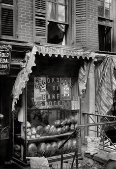 """New York circa 1910, somewhere on the Lower East Side. """"Bread for the poor."""" 5x7 glass negative, George Grantham Bain Collection"""