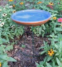s 13 awesome ways to reuse a terra cotta saucer, container gardening, gardening, repurposing upcycling, Set one on a tomato cage as a bird bath