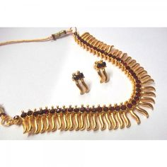 Buy Maroon Stone Golden Zigzak Necklace Set Online at cheap prices from Shopkio.com: India`s best online shoping site