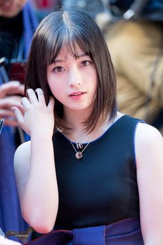 Kanna Hashimoto (橋本 環奈 Hashimoto Kan'na, born on February 3, 1999) is a Japanese idol singer and an actress managed by Yoshimoto R&C. She began her career as a member of the all-female pop group Rev. from DVL.