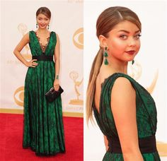 "Sarah Hyland was one of several actresses who opted for green on the red carpet. The ""Modern Family"" cutie models a lace-fringed, black-belted design from Carolina Herrera, which she sets off with enormous tiered emerald earrings, wine-red lips and a ponytail."