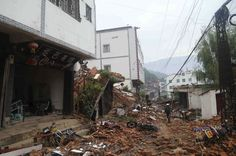 Deadly Magnitude 6.1 Earthquake Strikes Yunnan. This photo shows debris from ruined buildings. The photo was taken in the Longtoushan town. This town is in Yunnan China.