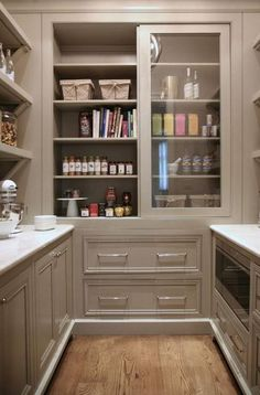 Really like the layout of this pantry. The counters, shelves, drawers, and the sliding glass door cabinet. Prefer crisp, white cabinets and do not need microwave so pull-out bin drawer and side area for oversized baking pans will be a good fit. And...dark hardwood floors or pop of tile color. #PantryIdeas