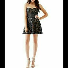 """NWT - GUESS 'Vanna' Textured Strapless Dress- SZ 4 Faux-leather applique adds eye-catching edge to this fashion forward mesh dress.  Plus the fit & flare silhouette flatters every figure,  making it a must-have addition to your wardrobe.  FROM BLOOMINGDALE'S  BRAND NEW, NEVER WORN SIZE: 4 BUST: 35 1/2""""     WAIST: 27""""     HIPS: 37 1/2""""  I pulled these 2 GUESS dresses for a pre-taped New Year's Eve segment to be aired. They did not fit the talent.  I work in L.A as a wardrobe stylist for film…"""