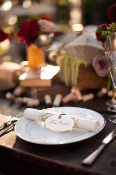 Wrap book pages around the napkins with the names of the guests.