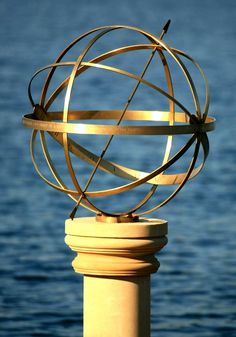 Armillary sphere sundial against water - stunning effect