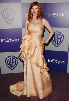 "Christina Hendricks on the red carpet wearing a gown by ""Project Runway"" winner Christian Siriano"