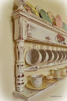 Tea cups displayed on old headboard