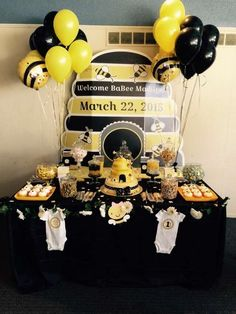 Black and  yellow dessert table at a bumble bee baby shower party! See more party planning ideas at CatchMyParty.com!