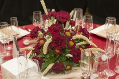 Love this #wedding #centerpiece by Browns Florist from the Designer Showdown. See more stunning designs just like this at the next Nashville PWG Wedding Show! #centerpiece #weddingfloral #redwedding #redfloral