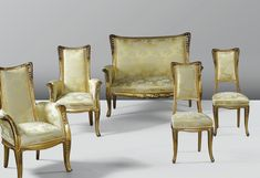 'FOUGÈRES', A CARVED GILT BEECH RE-UPHOLSTERED SALON SUITE BY LOUIS MAJORELLE, COMPRISING A SOFA, TWO ARMCHAIRS AND TWO SIDE CHAIRS, CIRCA 1905