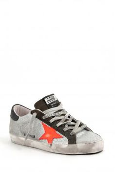 Golden Goose footwear - sneakers super star glitter silver/red fluo - Silver glittered sneakers from Golden Goose, with red/orange fluo leather star on the side, dark gray suede tongue  and outlines, white sponge and leather interiors, laced closure, black rubber sole. Insole heeled 2,5 cm. Golden Goose collection Autumn Winter 2013-2014. Golden Goose deluxe brand Venezia. Made in Italy.