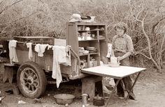 Todays picture is from a migrant workers camp in Texas during the Great Depression. A woman can be seen cooking from the back of a wagon. It looks to be the back end of a truck, converted into some sort of Chuck Wagon type structure.