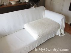 Cushions covered separately - brilliant way to keep couch cover tucked in.
